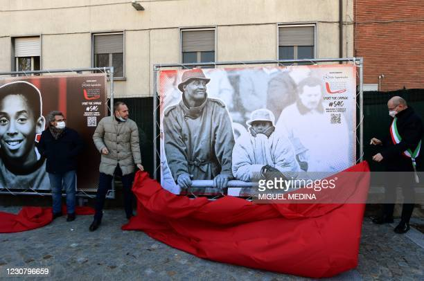 Reggio Emilia mayor Luca Vecchi unveils a photo exposition showing a boys Kobe and his father Joe Bryant after the inauguration ceremony of a square...
