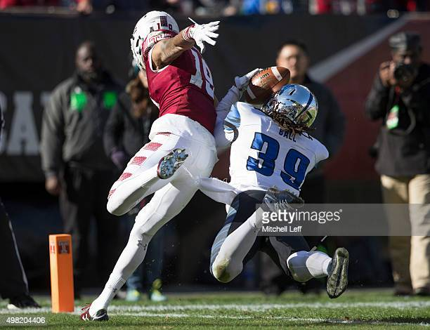 Reggis Ball of the Memphis Tigers intercepts a pass intended for Robby Anderson of the Temple Owls on November 21 2015 at Lincoln Financial Field in...