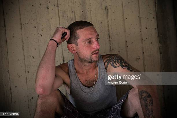 Reggy Colby age 30 and a recovering heroin addict sits under an overpass on August 21 2013 in Camden New Jersey Colby says he got out of jail two...