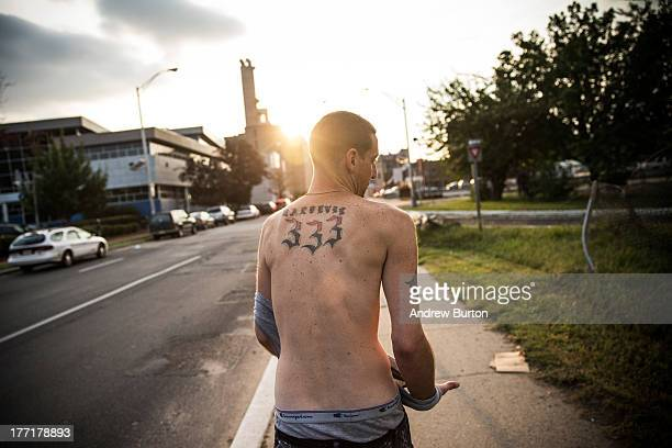 Reggy Colby age 30 and a recovering heroin addict walks down the street on August 21 2013 in Camden New Jersey Colby says he got out of jail two days...