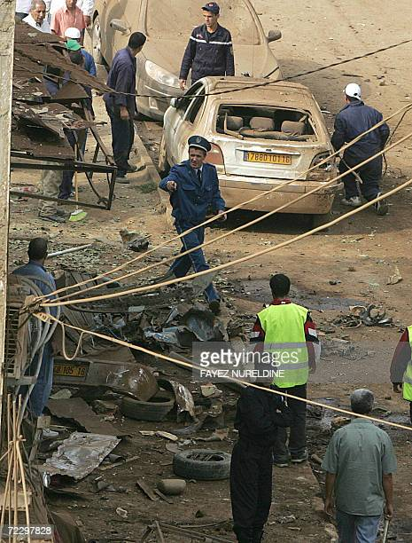 Algerian security and explosives experts check the site of an exeplosion that targeted a police post in Reghaia, some 30 kilometers east of the...