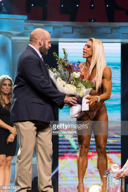 Regiane Da Silva is awarded second place in Fitness International as part of the Arnold Sports Festival on March 3 at the Greater Columbus Convention...