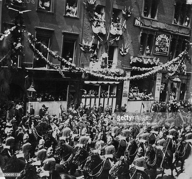A regiment of dragoons in Queen Victoria's Diamond Jubilee procession on Borough High Street London on their return to Buckingham Palace after a...