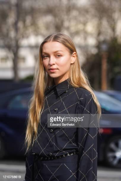 Regina Anikiy wears a black checked jacket, outside Chanel, during Paris Fashion Week - Womenswear Fall/Winter 2020/2021 on March 03, 2020 in Paris,...