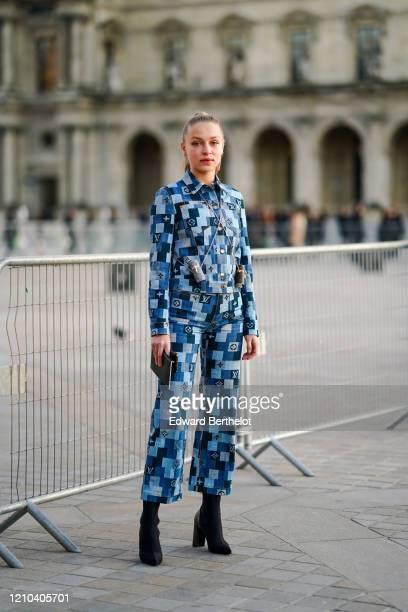 Regina Anikiy wears a blue checked pattern monogram Vuitton denim jacket, pants, two crossbody cylinder shaped mini bags, outside Vuitton, during...