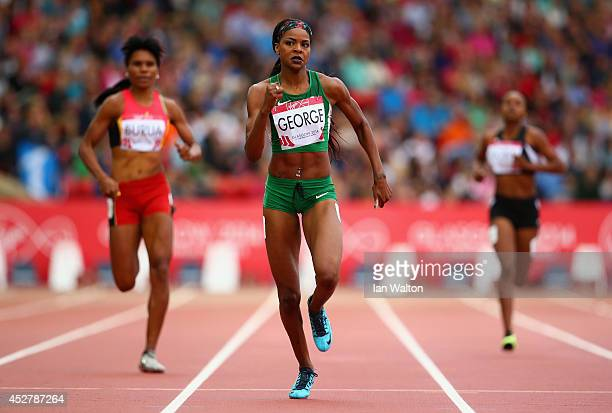 Regina George of Nigeria competes in the Women's 400 metres heats at Hampden Park Stadium during day four of the Glasgow 2014 Commonwealth Games on...