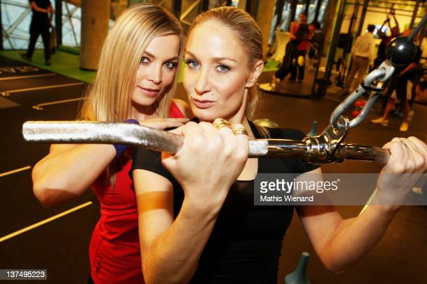 Regina Halmich and Janine Kunze pose at the Opening at Fitness First Platinum Club MyZeil on January 21 2012 in Frankfurt Germany