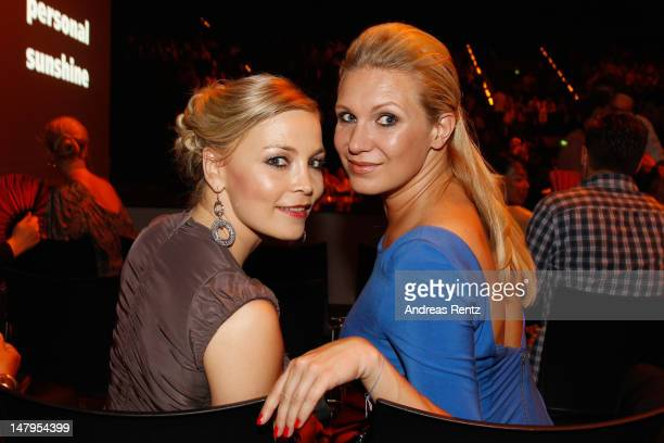 Regina Halmich and Magdalena Brzeska attend the Michalsky Style Nite 2012 at Mercedes-Benz Fashion Week Berlin Spring/Summer 2013 at Tempodrom on...