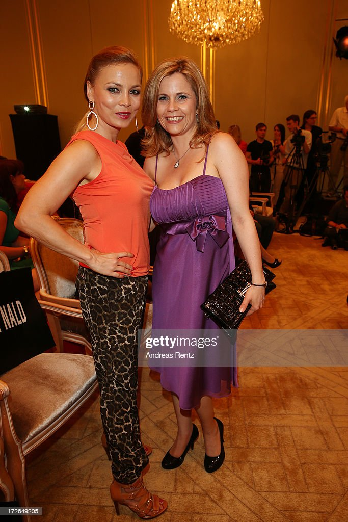 Regina Halmich and Michaela Schaffrath attend the Sava Nald Show during the Mercedes-Benz Fashion Week Spring/Summer 2014 at Hotel Adlon on July 4, 2013 in Berlin, Germany.