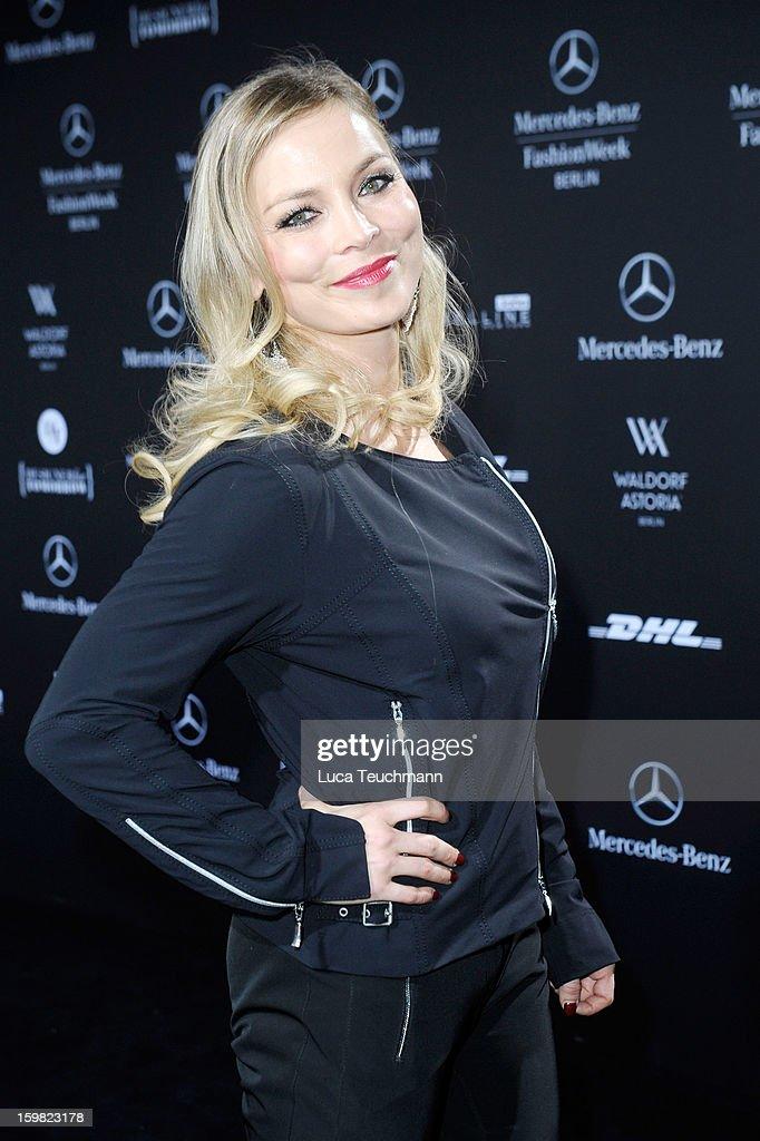 Regina Halmich attends Minx By Eva Lutz Autumn/Winter 2013/14 fashion show during Mercedes-Benz Fashion Week Berlin at Brandenburg Gate on January 16, 2013 in Berlin, Germany.