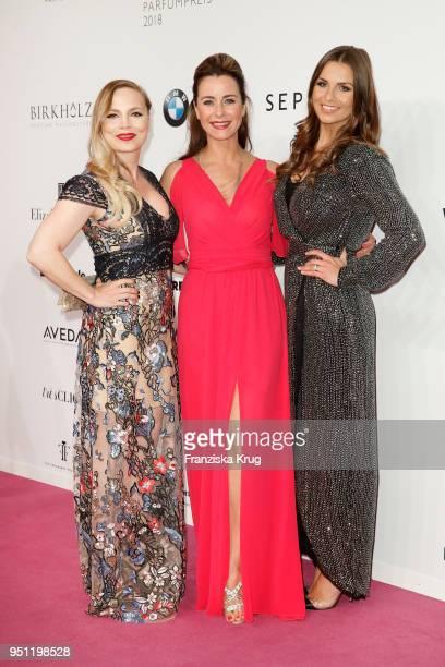 Regina Halmich Bettina Cramer and Laura Wontorra attend the Duftstars at Flughafen Tempelhof on April 25 2018 in Berlin Germany
