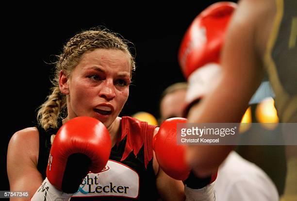Regina Halmich boxes Viktoria Milo during the WIBF Women flyweight world championship fight between Regina Halmich of Germany and Viktoria Milo of...