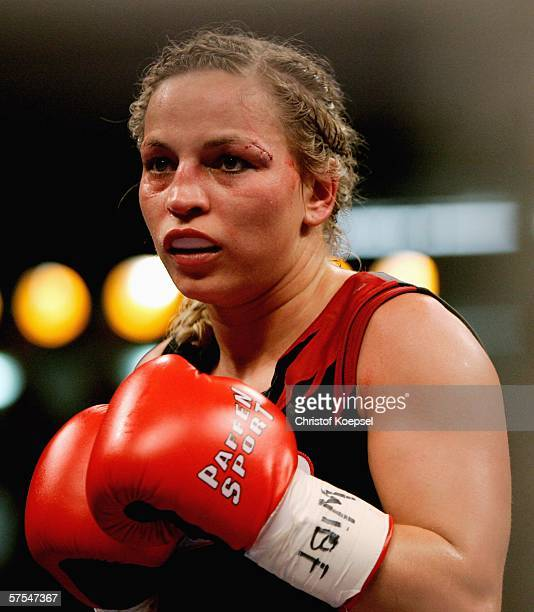 Regina Halmich boxes with a stitched eyebrow during the WIBF Women flyweight world championship fight between Regina Halmich of Germany and Viktoria...