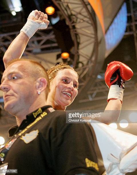 Regina Halmich celebrates her 50th victory after the WIBF Women flyweight world championship fight between Regina Halmich of Germany and Viktoria...
