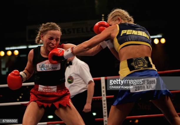 Regina Halmich jabs Viktoria Milo during the WIBF Women flyweight world championship fight between Regina Halmich of Germany and Viktoria Milo of...