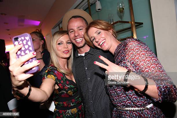 Regina Halmich Marlon Roudette and Mareile Hoeppner during the 50th Anniversary of AIGNER on April 16 2015 in Munich Germany