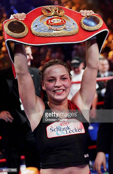 Regina Halmich of Germany celebrates winning the fight against Elena Reid of US during the Women's WIBF Flyweight Championship fight between Regina...