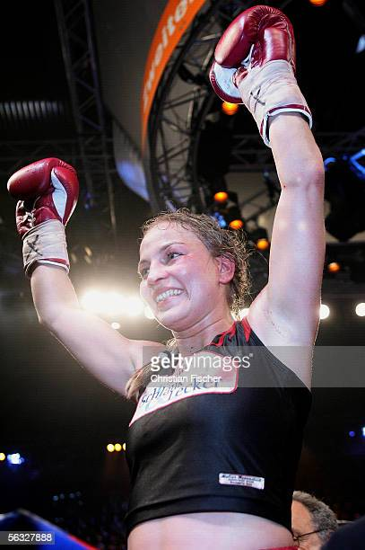Regina Halmich of Germany celebrates winning the fight against Elena Reid of USA during the Women's WIBF Flyweight Championship fight between Regina...