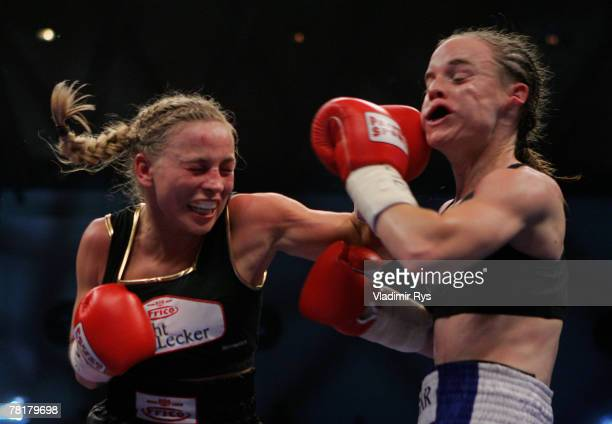 Regina Halmich of Germany lands a punch against Hagar Shmoulefeld Finer of Israel during their WIBF World Championship flyweight title fight at the...