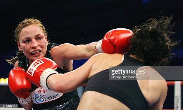 Regina Halmich of Germany punches Reka Krempf of Hungary during the IBF Flyweight fight at the Brandenberge Arena on January 13, 2007 in Halle,...