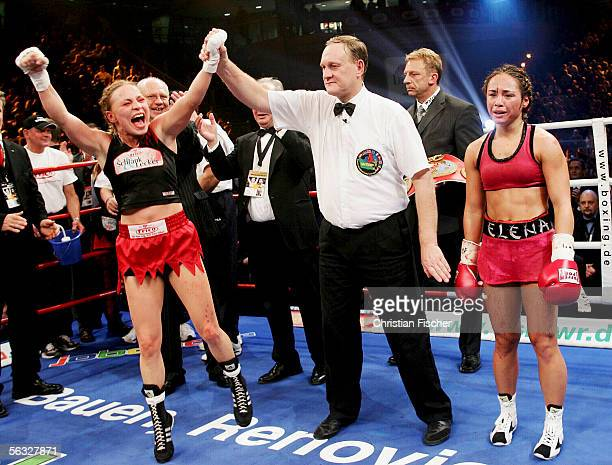 Regina Halmich of Germany reacts after winning the fight against Elena Reid of US during the Women's WIBF Flyweight Championship fight between Regina...