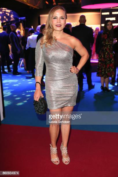 Regina Halmich wearing a silver dress by Sonja Kiefer during the 'Tribute To Bambi' gala at Station on October 5 2017 in Berlin Germany
