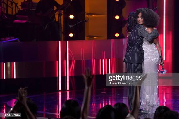 Regina King and Angela Bassett embrace onstage at Black Girls Rock 2019 Hosted By Niecy Nash at NJPAC on August 25, 2019 in Newark, New Jersey.