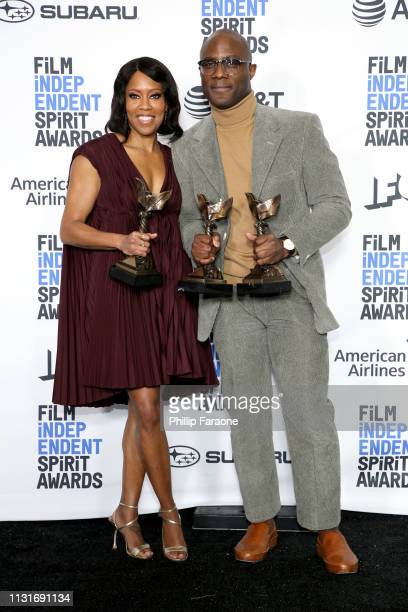 """Regina King and Barry Jenkins pose in the press room with the Best Supporting Female Best Director and Best Feature awards for the film """"If Beale..."""