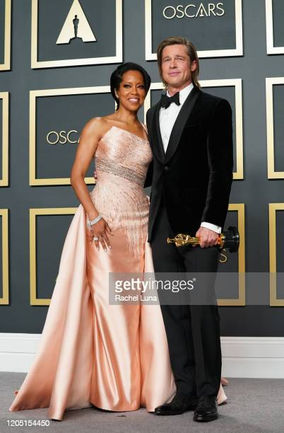 """Regina King and Brad Pitt, winner of Best Actor in a Supporting Role for """"Once Upon a Time...in Hollywood"""" pose in the press room during 92nd Annual..."""