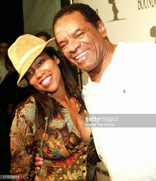 Regina King and John Witherspoon during The Boondocks Los Angeles Series Launch Party at Mood in Hollywood California United States