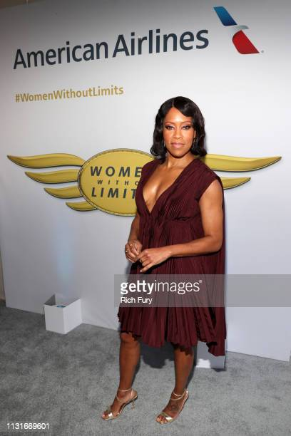 Regina King poses with the American Airlines banner during the 2019 Film Independent Spirit Awards on February 23 2019 in Santa Monica California