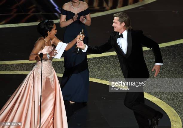 Regina King presents the Actor in a Supporting Role award for 'Once Upon a Timein Hollywood' to Brad Pitt onstage during the 92nd Annual Academy...
