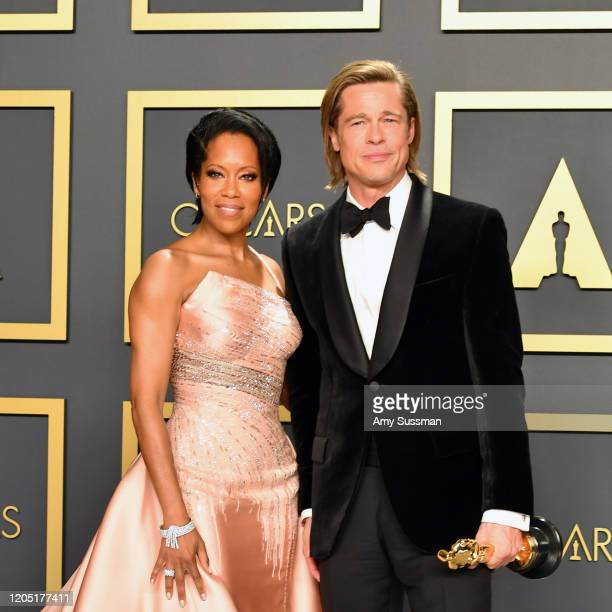 """Regina King with Brad Pitt, winner of the Actor in a Supporting Role award for """"Once upon a Time...in Hollywood,"""" poses in the press room during the..."""