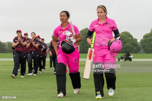 Regina Lili'i and Felicity LeydonDavis of the Spirit walk from the ground after winning the Women's Twenty20 match between the Canterbury Magicians...