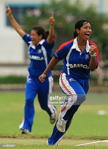 Regina Lili'i of Samoa celebrates taking a wicket during the semi final match between Papua New Guinea and Samoa played at Independence park during...