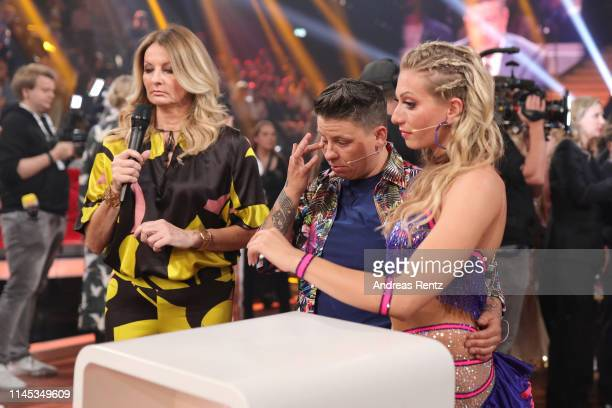 Regina Luca and Kerstin Ott react prior to an interview with Frauke Ludowig during the 5th show of the 12th season of the television competition...