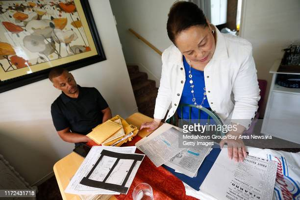 Regina Mason right and film director director Sean Durant left look over historical documents on Tuesday April 4 in Oakland Calif Mason spent 15...