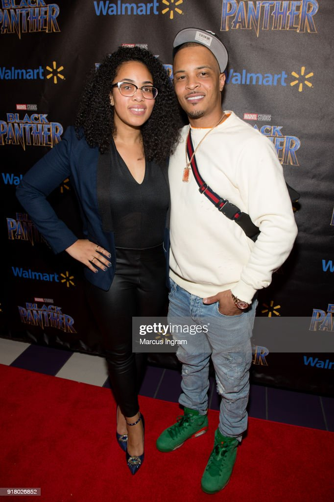 Regina Moore (Walmart) and Clifford 'T.I.' Harris attend Marvel Studios Black Panther advance screening at Regal Hollywood on February 13, 2018 in Chamblee, Georgia.