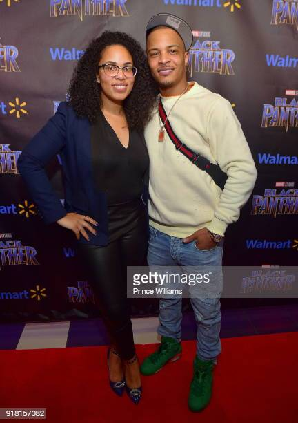 Regina Moore and TI attend 'Black Panther' advance Screening at Regal Hollywood on February 13 2018 in Chamblee Georgia