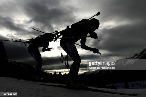 Regina Oja of Estonia competes with Susan Dunklee of USA during the Single Mixed Relay at the IBU World Championships Biathlon Antholz-Anterselva on...