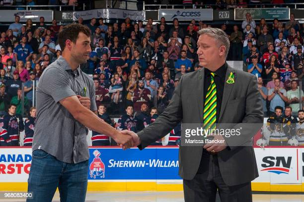 Regina Pats alumni Jordan Eberle of the New York Islanders shakes the hand of Humboldt Broncos President Kevin Garinger at the beginning of the...