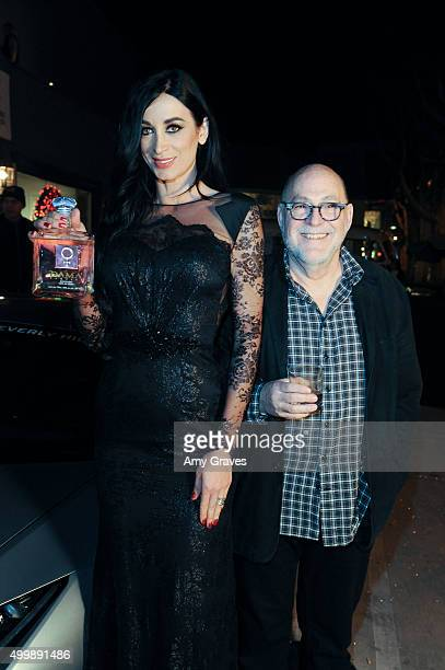 Regina Salpagarova and Joe Mannis attend the Project Divine from JGerard Peace Gallery a VIP celebrity cocktail event with black Carpet and silent...