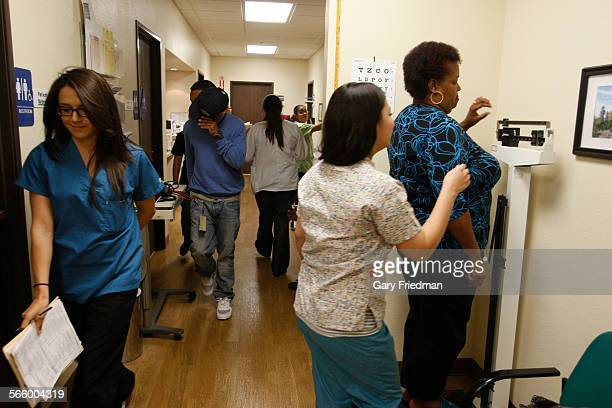 Regina Tate has her wieght taken before an examination at the Antelope Valley Community Clinic in Lancaster on April 11 2012 Regina goes to the...