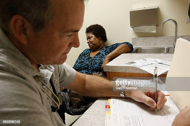 Regina Tate speaks to James Gocke a family nurse practitioner during an examination at the Antelope Valley Community Clinic in Lancaster on April 11...