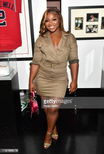 Reginae Carter attends the Nipsey Hussle Exhibit Unveiling at The Trap Music Museum on August 13 2019 in Atlanta Georgia