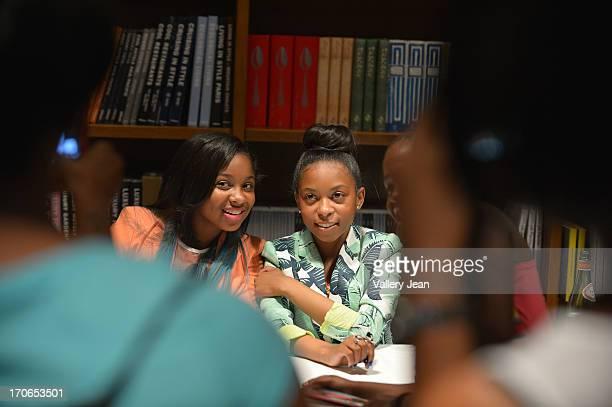 Reginae Carter daughter of rapper Lil' Wayne and Bria Williams daughter of Bryan 'Birdman' Williams greet fans and sign copies of their book...