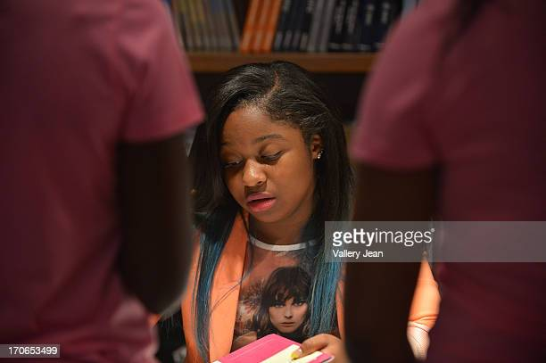 Reginae Carter daughter of rapper Lil' Wayne greet fans and sign copies of her book 'Paparazzi Princesses' at Books and Books on June 15 2013 in...