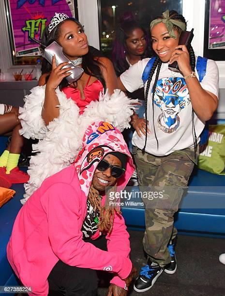 Reginae Carter Lil Wayne and Antonia 'Toya' Wright attend Reginae Carters Birthday Party at Suite Lounge on December 2 2016 in Atlanta Georgia