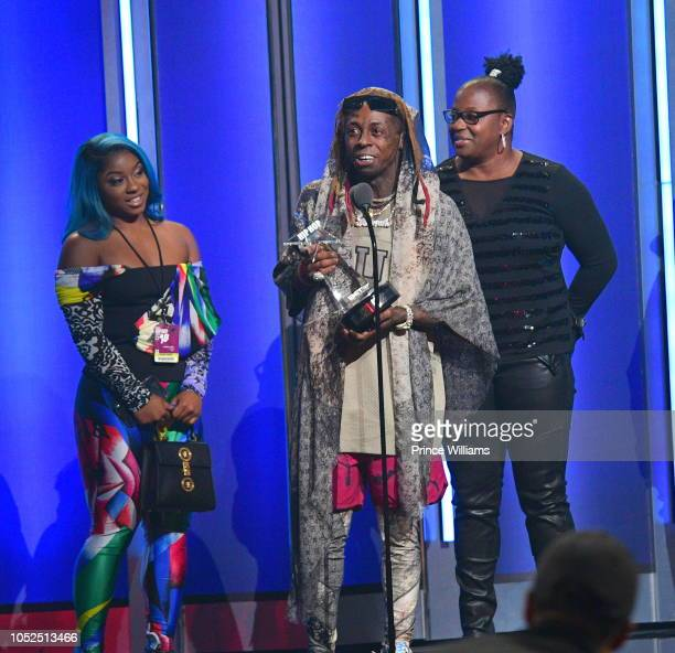 Reginae Carter Lil Wayne and Jacida Carter attend at the BET Hip Hop Awards 2018 at Fillmore Miami Beach on October 6 2018 in Miami Beach Florida