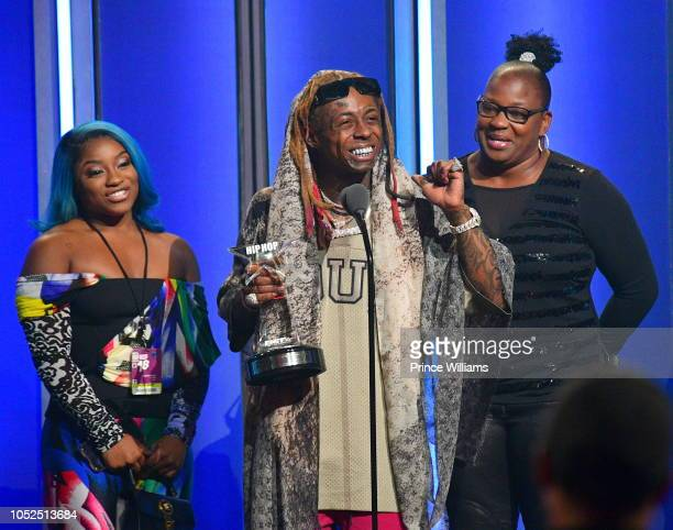 Reginae Carter Lil Wayne and Jacida Carter attend at the BET Hip Hop Awards 2018 at Fillmore Miami Beach on October 6 2018 in Miami Beach Florida